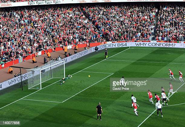 Emmanuel Adebayor of Tottenham scores from the penalty spot during the Barclays Premier League match between Arsenal and Tottenham Hotspur at...