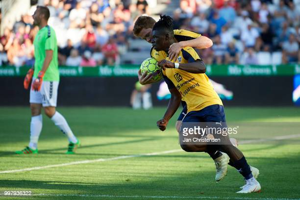 Emmanuel Afriyie Mario Sabbi of Hobro IK and teammate celebrate after his 21 goal during the Danish Superliga match between Vejle Boldklub and Hobro...