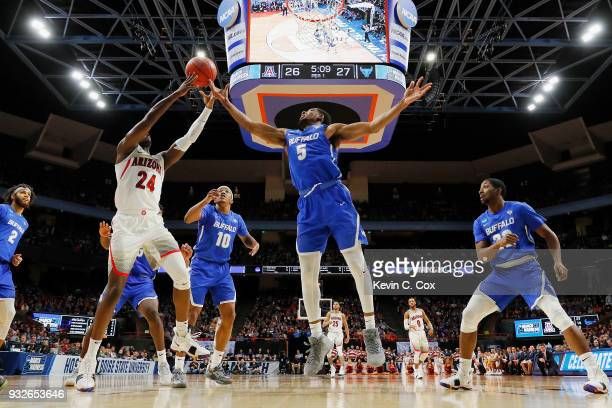 Emmanuel Akot of the Arizona Wildcats battles for a rebound with CJ Massinburg of the Buffalo Bulls in the first half during the first round of the...