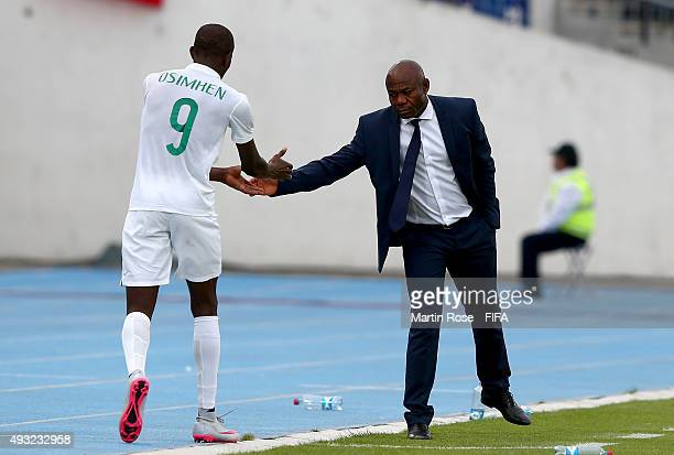 Emmanuel Amunike, head coach of Nigeria shake hands with Victor Osimhen during the FIFA U-17 Men's World Cup 2015 group A match between Nigeria and...