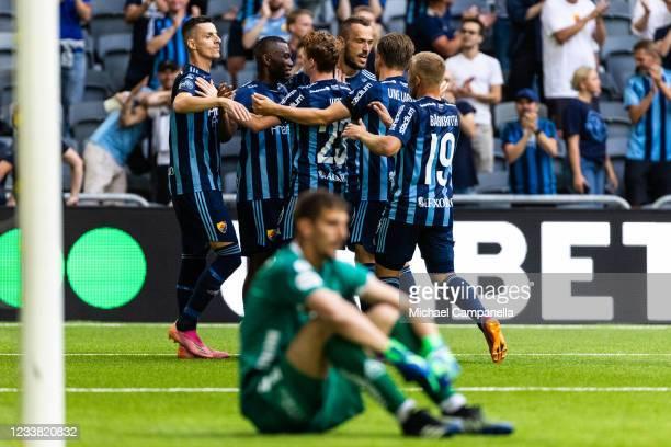Emmanuel Banda celebrates with teammates scoring the 3-0 goal during the Allsvenskan match between Djurgardens IF and Orebro SK at Tele2 Arena on...