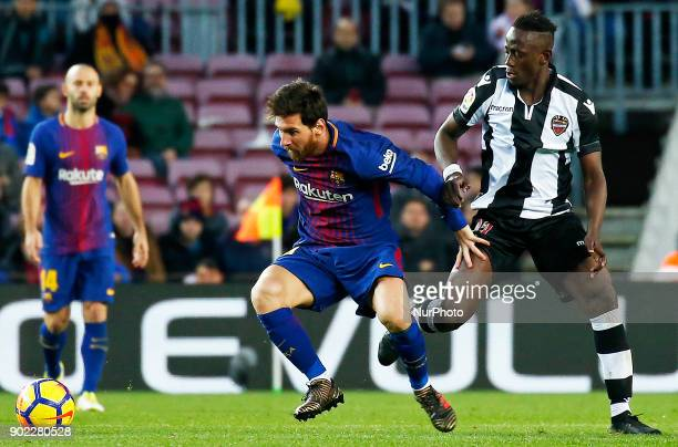 Emmanuel Boateng and Leo Messi during theLa Liga match between FC Barcelona and Levante UD in Barcelona on January 07 2018
