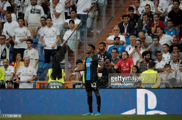Emmanuel Bonaventure Dennis of Club Brugge celebrates after scoring a goal during the UEFA Champions League group A match between Real Madrid and...