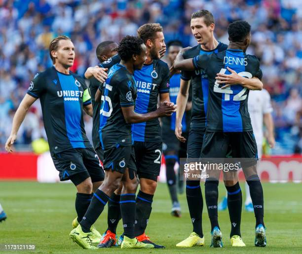 Emmanuel Bonaventure Dennis of Club Brugge celebrates his goal with team mates during the UEFA Champions League group A match between Real Madrid and...