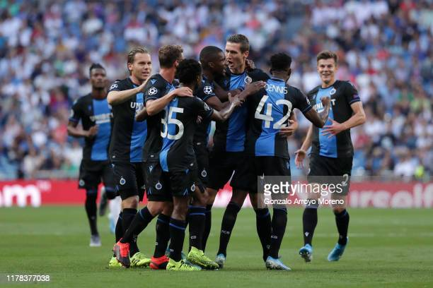 Emmanuel Bonaventure Dennis of Club Brugge celebrates with teammates after scoring his team's first goal during the UEFA Champions League group A...