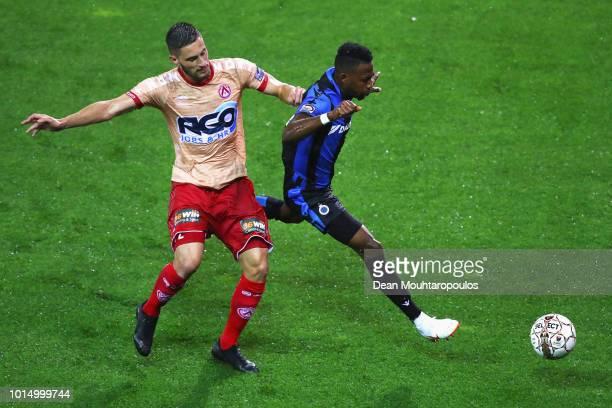 Emmanuel Bonaventure Dennis of Club Brugge KV battles for the ball with Petar Golubovic of KV Kortrijk during the Jupiler Pro League match between...
