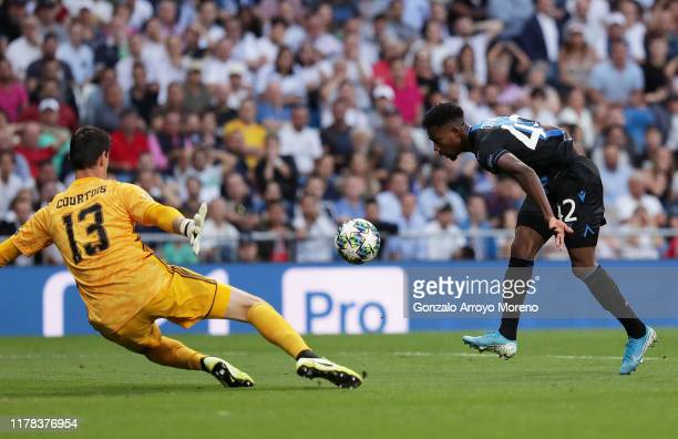 Emmanuel Bonaventure Dennis of Club Brugge scores his team's second goal during the UEFA Champions League group A match between Real Madrid and Club...
