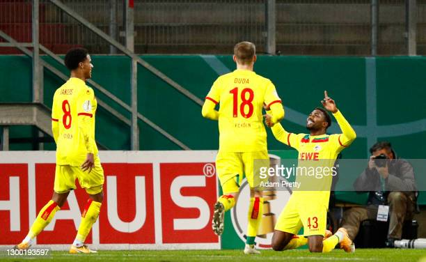 Emmanuel Bonaventure of 1. FC Koeln celebrates after scoring their side's first goal during the DFB Cup Round of Sixteen match between Jahn...