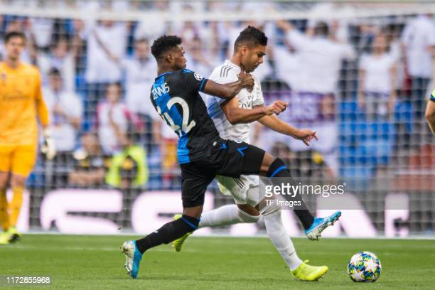 Emmanuel Bonaventure of Club Brugge and Casemiro of Real Madrid battle for the ball during the UEFA Champions League group A match between Real...