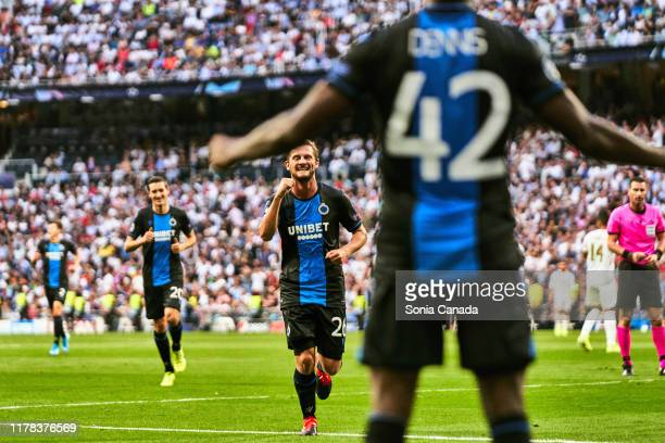 Emmanuel Bonaventure of Club Brugge celebrates after scoring his team's second goal during the UEFA Champions League group A match between Real...