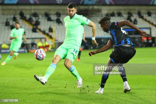 Emmanuel Bonaventure of Club Brugge KV crosses the ball whilst under pressure from Wesley Hoedt of SS Lazio during the UEFA Champions League Group F...