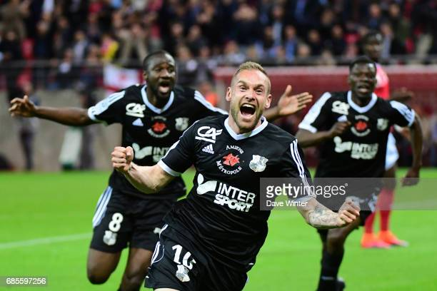 Emmanuel Bourgaud of Amiens scores in the sixth minute of injury time to see his team promoted during the Ligue 2 match between Stade de Reims and...
