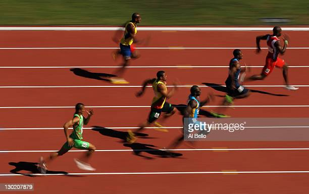 Emmanuel Callender of Trinidad and Tobago leads the field in the men's 100m heat during Day 10 of the XVI Pan American Games at Telcel Athletics...