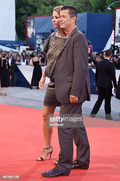 Emmanuel Carrere and Helene Devynck attend a premiere for 'Remember' during the 72nd Venice Film Festival at Sala Grande on September 10, 2015 in...