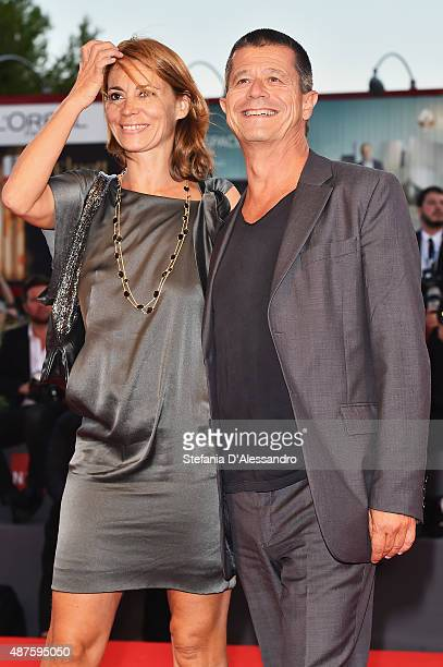 Emmanuel Carrere and Helene Devynck attend a premiere for 'Remember' during the 72nd Venice Film Festival at Sala Grande on September 10 2015 in...