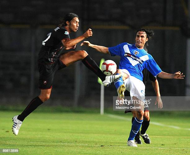 Emmanuel Cascione of Reggina and Andrea Caracciolo of Brescia challenge for the ball during the TIM Cup 3rd round match between Brescia Calcio and...