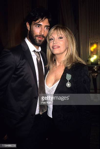 Emmanuel Casella and Amanda Lear during Amanda Lear and Enrico Navarra Receive the Chevaliers des Arts et des Lettres Medal at Ministere de La...