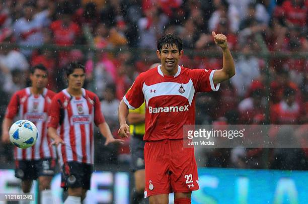 Emmanuel Cerda of Toluca celebrates a scored goal during a match against Chivas as part of the Clausura Tournament in the Mexican Football League at...