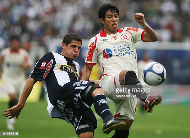 Emmanuel Cerda of Universitario de Deportes vies for the ball with Aldo Corzo of the Alianza Lima during their Copa Cable Magico first leg soccer...