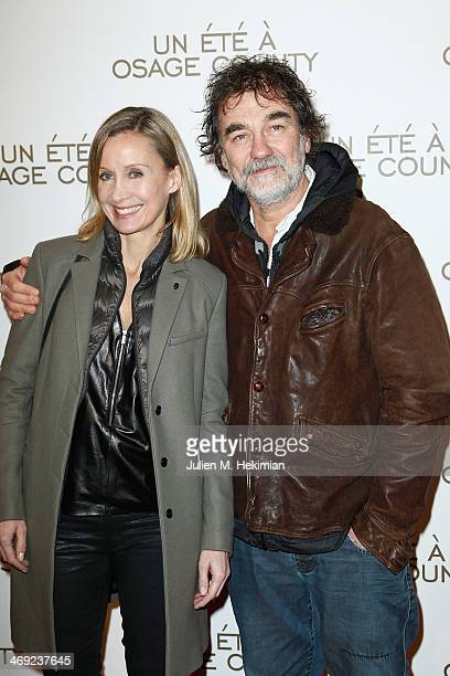 Emmanuel Chain and his wife Catherine attend the 'August Osage County' Paris premiere at Cinema UGC Normandie on February 13 2014 in Paris France