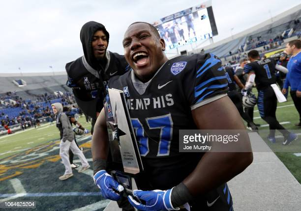 Emmanuel Cooper of the Memphis Tigers celebrates with the AAC West Division trophy against the Houston Cougars during the second half on November 23,...