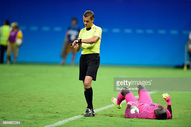 Emmanuel Daniel goalkeeper of Nigeria goes down injured during 2016 Summer Olympics match between Japan and Nigeria at Arena Amazonia on August 4...