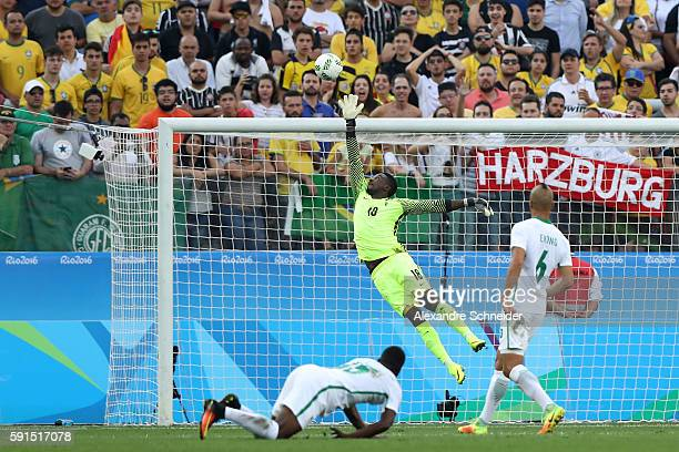 Emmanuel Daniel of Nigeria attempts to save a shot at goal during the Men's Semifinal Football match between Nigeria and Germany on Day 12 of the Rio...