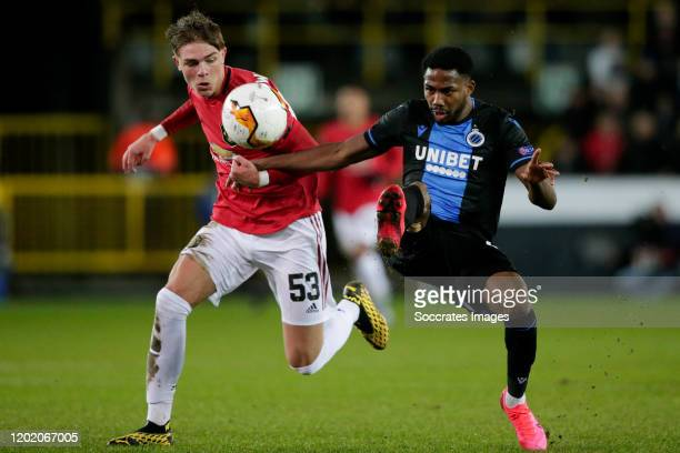 Emmanuel Dennis of Club Brugge, scores the first goal to make it 1-0, Brandon Williams of Manchester United during the UEFA Europa League match...