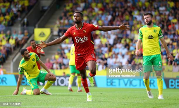 Emmanuel Dennis of Watford FC celebrates after scoring their team's first goal during the Premier League match between Norwich City and Watford at...