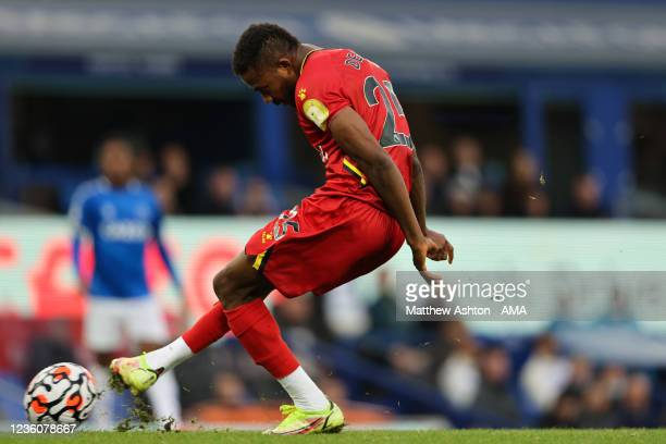 Emmanuel Dennis of Watford scores a goal to make it 2-5 during the Premier League match between Everton and Watford at Goodison Park on October 23,...