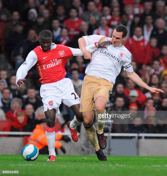 Emmanuel Eboue of Arsenal and Emanuel Pogatetz of Middlesbrough in action during the Barclays Premier League match between Arsenal and Middlesbrough...