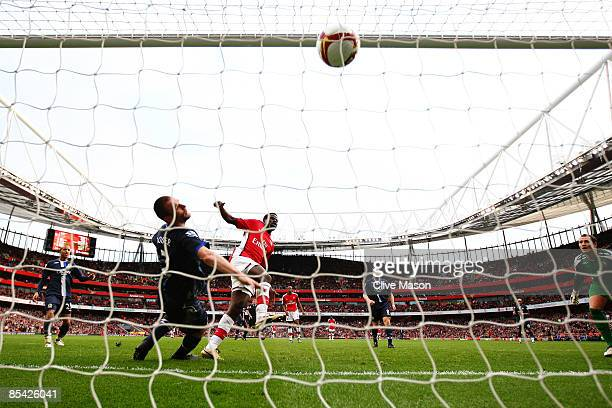 Emmanuel Eboue of Arsenal scores their third goal during the Barclays Premier League match between Arsenal and Blackburn Rovers at Emirates Stadium...