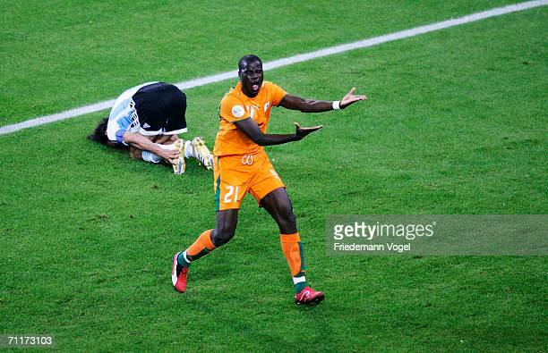 Emmanuel Eboue of Ivory Coast protests to the referee as Juan Sorin of Argentina lies on the ground during the FIFA World Cup Germany 2006 Group C...