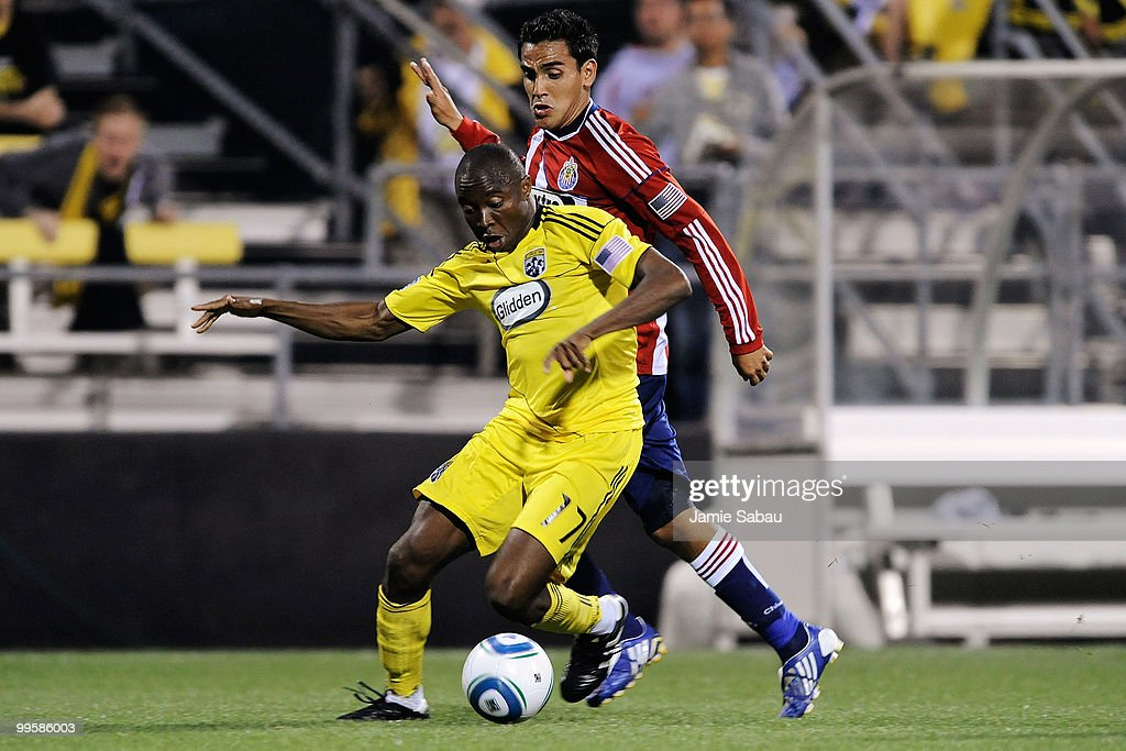 Emmanuel Ekpo #17 of the Columbus Crew holds off Jesus Padilla #10 of Chivas USA as he controls the ball on May 15, 2010 at Crew Stadium in Columbus, Ohio.