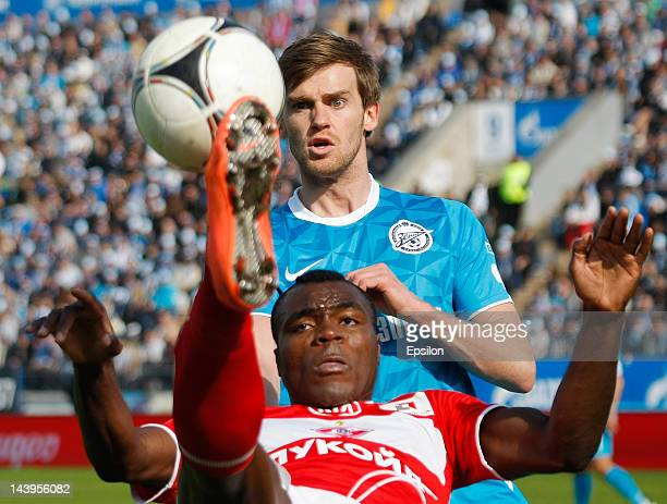 Emmanuel Emenike of FC Spartak Moscow and Nicolas Lombaerts of FC Zenit St Petersburg vie for the ball during the Russian Football League...