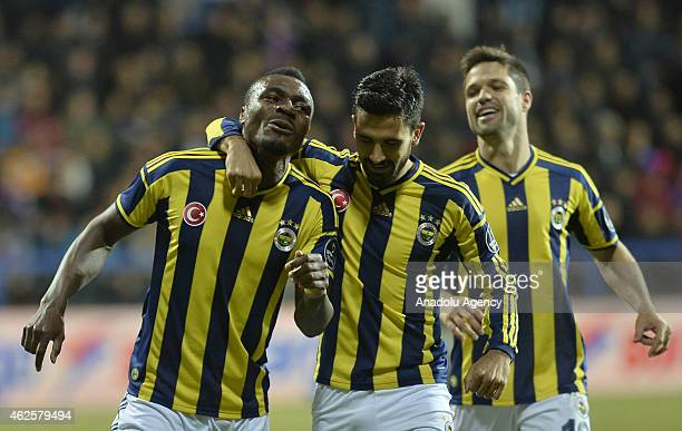 Emmanuel Emenike of Fenerbahce celebrates with his teammates Diego Ribas da Cunha and Alper Potuk after scoring a goal during Turkish Spor Toto Super...