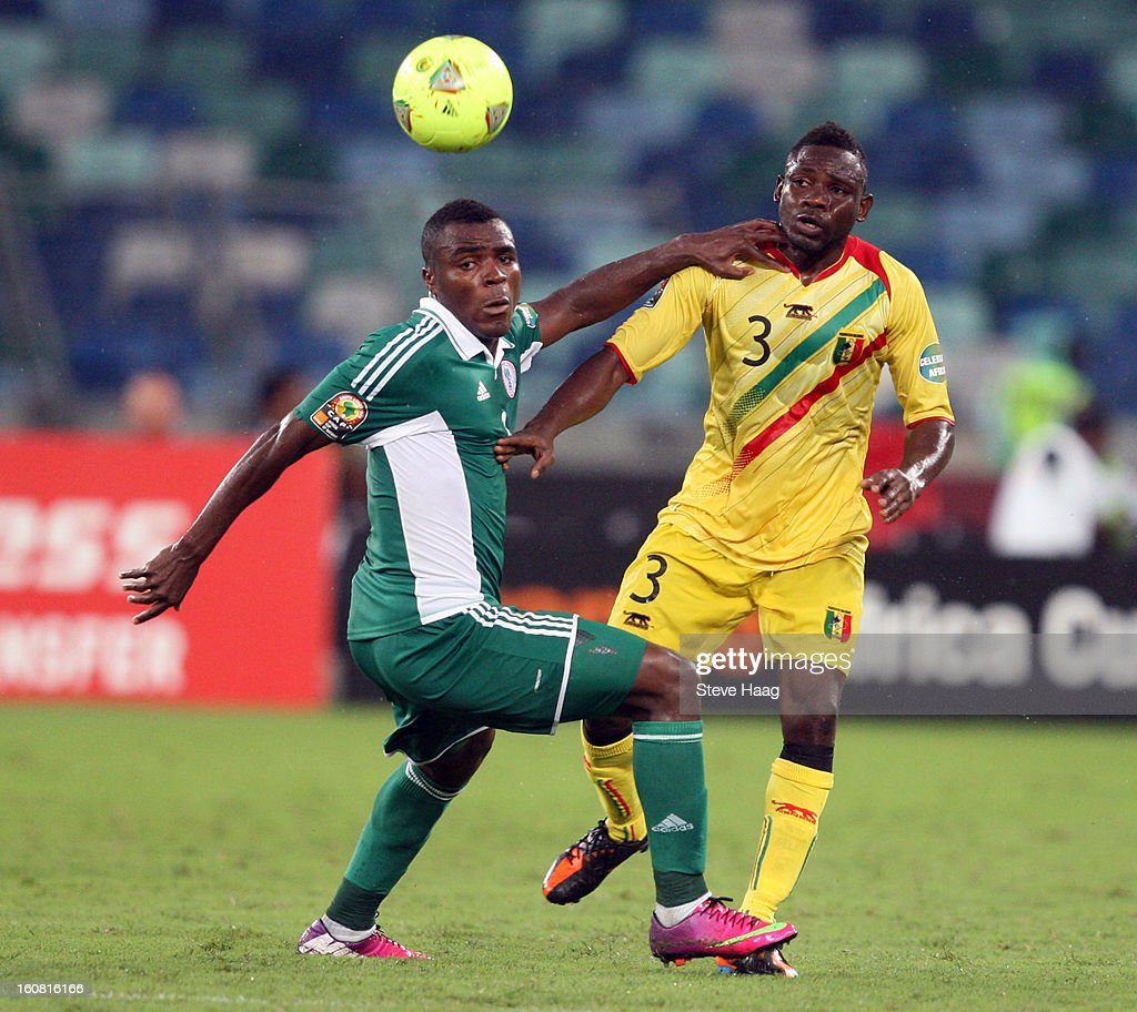 Emmanuel Emenike of Nigeria competes for the ball with Adama Tamboura of Mali during the 2013 African Cup of Nations Semi-Final match between Mali and Nigeria at Moses Mahbida Stadium on February 06, 2013 in Durban, South Africa.
