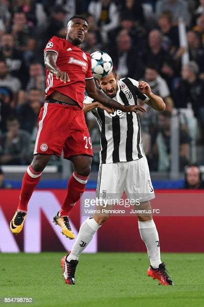 Emmanuel Emenike of Olympiacos and Giorgio Chiellini of Juventus competes for the ball during the UEFA Champions League group D match between...