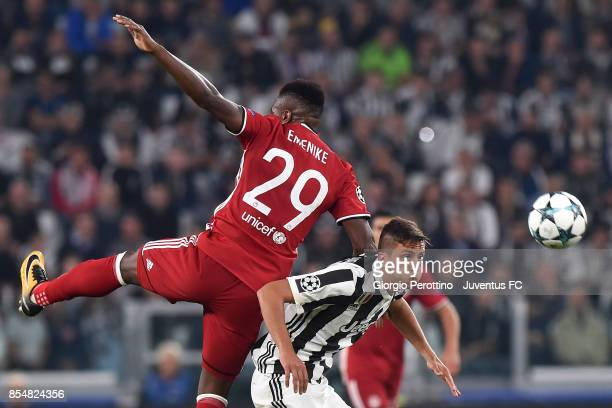 Emmanuel Emenike of Olympiacos Piraeus clashes with Rodrigo Bentancur of Juventus during the UEFA Champions League group D match between Juventus and...
