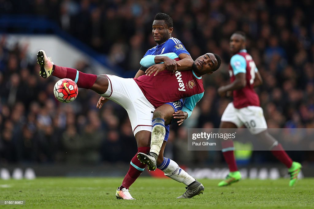 Emmanuel Emenike of West Ham United and John Mikel Obi of Chelsea compete for the ball during the Barclays Premier League match between Chelsea and West Ham United at Stamford Bridge on March 19, 2016 in London, United Kingdom.