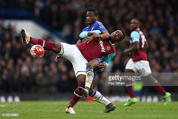 Emmanuel Emenike of West Ham United and John Mikel Obi of Chelsea compete for the ball during the Barclays Premier League match between Chelsea and...
