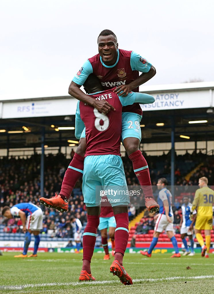 Emmanuel Emenike of West Ham United celebrates with teammate Cheikhou Kouyate #8 after scoring his team's third goal during The Emirates FA Cup fifth round match between Blackburn Rovers and West Ham United at Ewood park on February 21, 2016 in Blackburn, England.