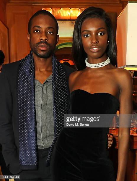 Emmanuel Ezugwu and Leomie Anderson attend the launch of the Annabel's Smoking Jacket by Casely Hayford at Annabel's on October 12 2016 in London...