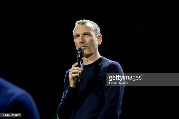 Emmanuel Faber CEO of Danone speaks to attendees during a plenary session during the Sustainable Brands Paris conference in the Carrousel du Louvre...