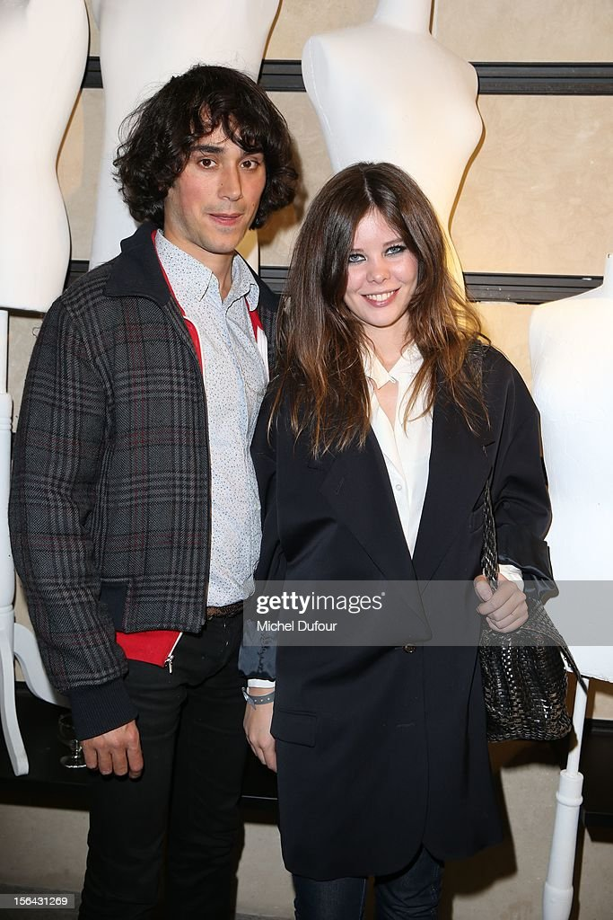 Emmanuel Fontanesi and Lou Lesage attend the Maison Martin Margiela With H&M Collection Launch at H&M Champs Elysees on November 14, 2012 in Paris, France.