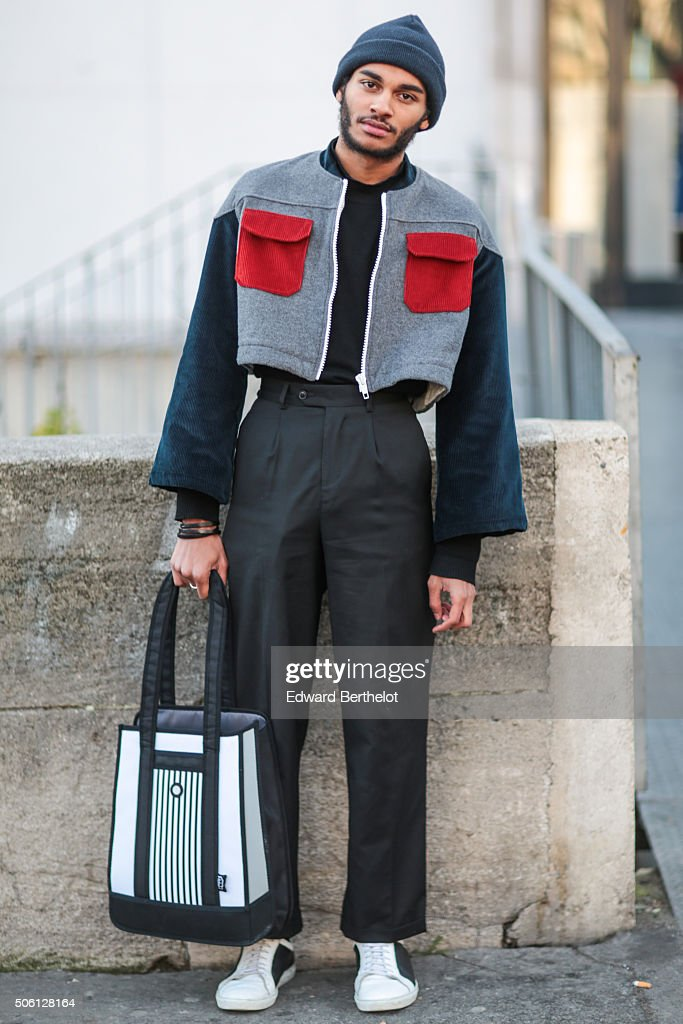 Emmanuel Fours wearing a Sans Culotte Sans Papiers jacket, a Jump From Paper bag and Agns B. shoes, after the Rick Owens show during Paris Fashion Week Menswear Fall Winter 2016/2017 on January 21, 2016 in Paris, France.