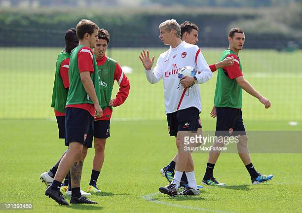 Emmanuel Frimpong Aaron Ramsey and Samir Nasri talk with Arsenal manager Arsene Wenger during a training session at London Colney on August 19 2011...