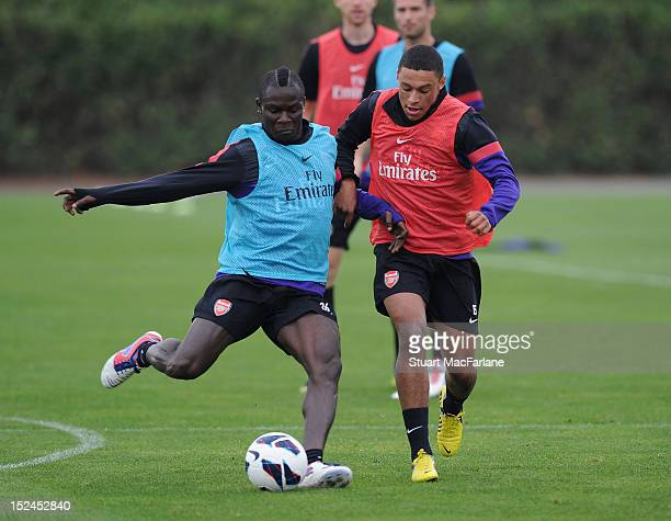 Emmanuel Frimpong and Alex Oxlade-Chamberlain of Arsenal during a training session at London Colney on September 21, 2012 in St Albans, England.