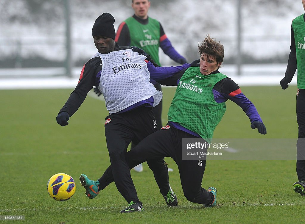 Emmanuel Frimpong (L) and Andrey Arshavin of Arsenal during a training session at London Colney on January 22, 2013 in St Albans, England.