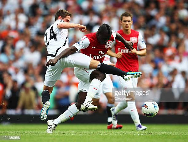 Emmanuel Frimpong of Arsenal battles with Joe Allen of Swansea City during the Barclays Premier League match between Arsenal and Swansea City at...